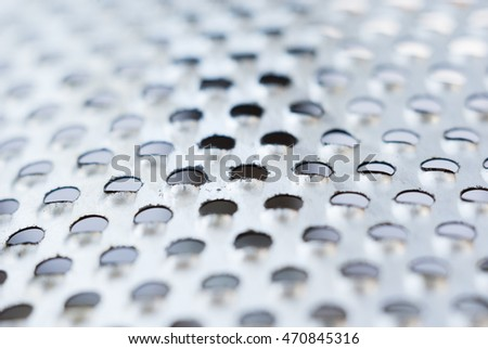 Perforated metal background image. - Stock image
