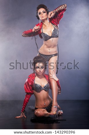 Performance. Couple of Women in Theatrical Costumes. Nightlife - stock photo
