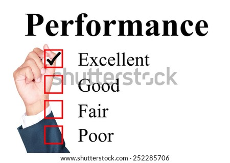 Performance evaluation form tick excellent by businessman - stock photo