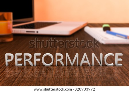 Performance - letters on wooden desk with laptop computer and a notebook. 3d render illustration.