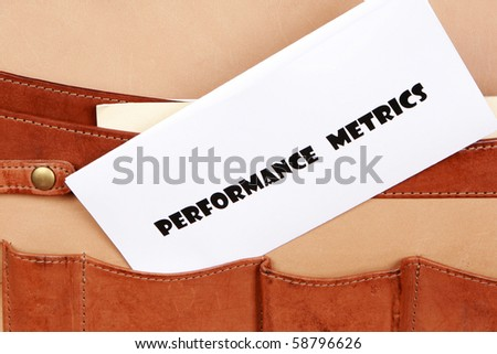 Performance Metric documents in a briefcase - stock photo
