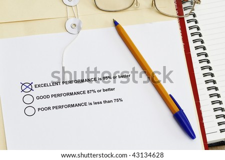 Performance Survey  with training materials like envelope,spiral notebook and ballpen. - stock photo