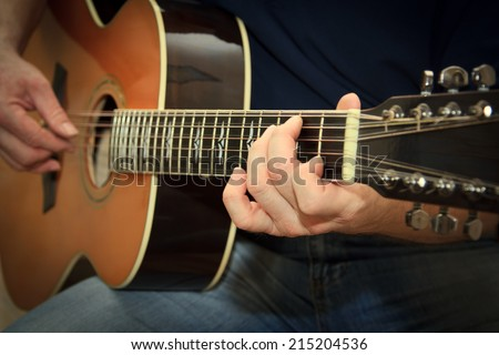 performer playing on the acoustic guitar - stock photo