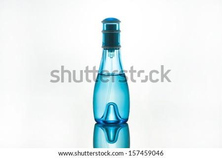 perfume bottle before white background - stock photo