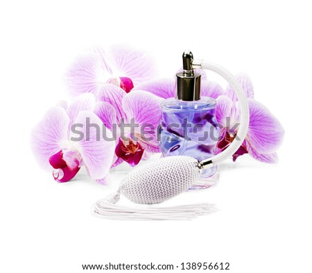 Perfume bottle surrounded by beautiful orchids. - stock photo