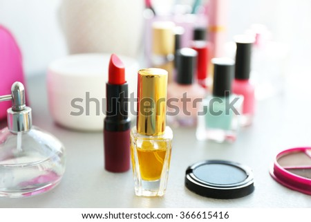 Perfume bottle with makeup cosmetics on a table