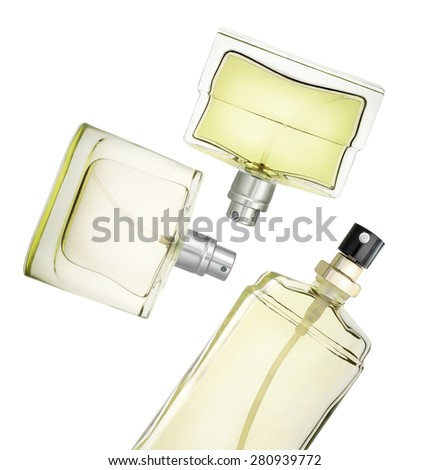Perfume bottles floating against white background. Clipping path - stock photo