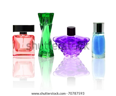 Perfume color glass bottles isolated on white with transparent reflection. - stock photo