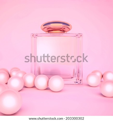 Perfume in a glass bottles and pearl beeds on pink. - stock photo