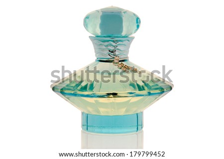 Perfume in an elegant bottle on a clean white background - stock photo