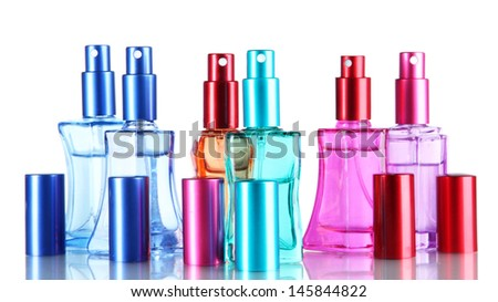 Perfume in bottles isolated on white - stock photo