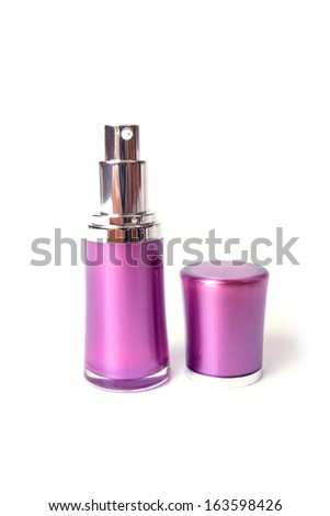 Perfume spray bottle on white background.
