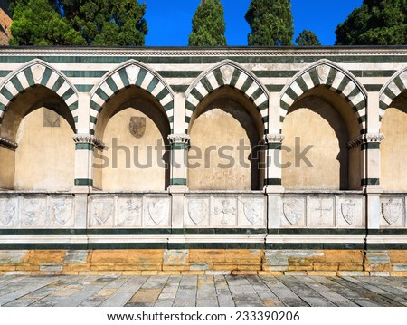 Perimeter wall of the cloister of the Basilica of Santa Maria Novella in white marble and green serpentine in Florence UNESCO world heritage site, Tuscany Italy - stock photo