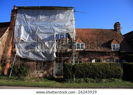 Period cottage in a Buckinghamshire village under roof repair and renovation following a fire - stock photo