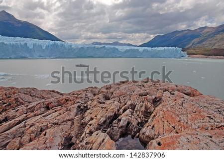Perito Moreno Glacier and Ship for scale, Argentina - stock photo