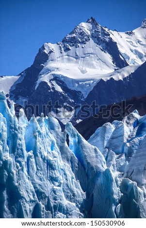 Perito Moreno glacier in front of Andes mountains - stock photo