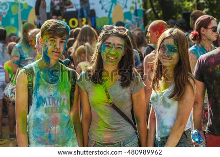 Perm, Russia, August 19th-2016, park Gorkogo. Happy young gues having fun together and posing in camera at Holi color festival.