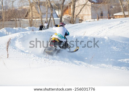 Perm, Russia - February 23, 2015. Championship on Cross Country Snowmobiles. racer on snowmobile  in winter tracks