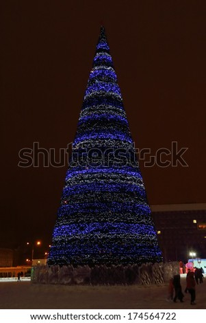 PERM, RUSSIA - JAN 11, 2014: Christmas tree in Ice town at evening. Construction of Ice town of Perm was spent 590 thousand dollars. - stock photo