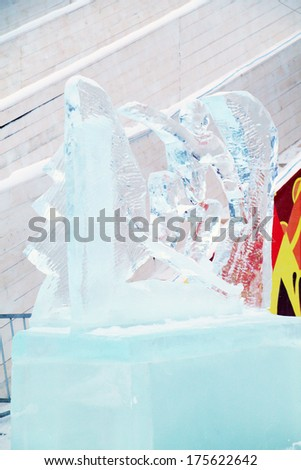 PERM, RUSSIA - JAN 6, 2014: Snowboarder sculpture in Ice town, created in honor of Winter Olympic Games 2014 will be in Sochi, Russia. - stock photo