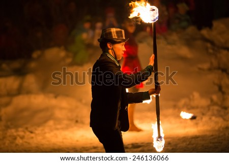 Perm, Russia - January 17, 2015. man with fiery mace stands sideways - stock photo