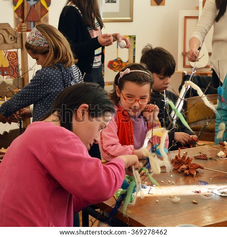 PERNIK, BULGARIA â?? Januarry 29, 2016: Traditional arts and crafts workshop for children and young handicapped people during Surva festival in Pernik - stock photo