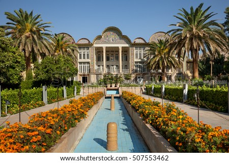 Persian Garden Of Eram With Its Beautiful Pavilion, Traditional Iranian  Fountain System And Palm Trees