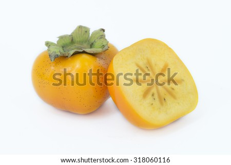 Persimmon and half sliced on white background