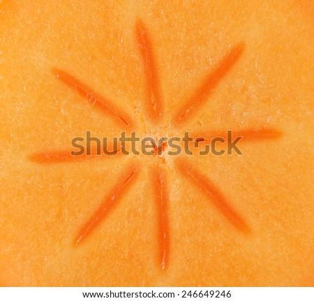 Persimmon slice - texture - stock photo