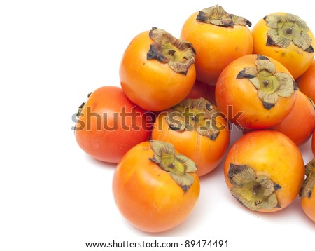 persimmons and empty space for your text - stock photo