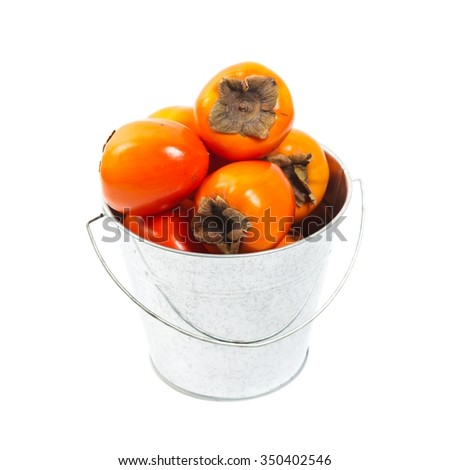 Persimmons on white background. Selective focus. - stock photo
