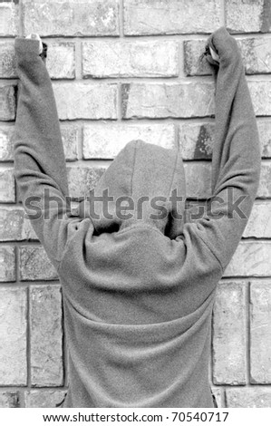 person banging hands against wall - stock photo
