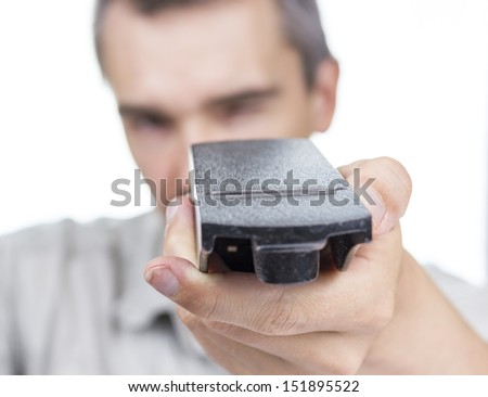 Person checking cutting edge of wood planer, isolated on white, narrow focus on blade. - stock photo