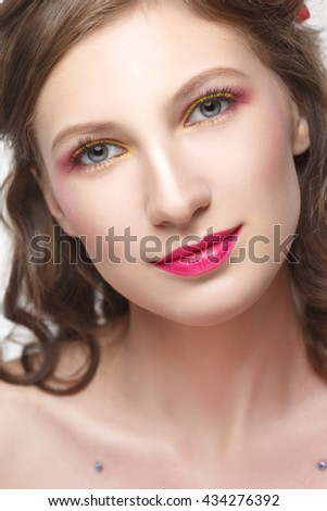 Person cute smiling girl with make-up in pink tones