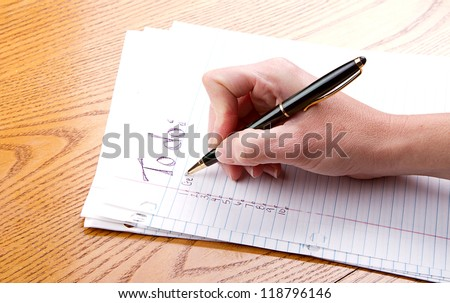 Person filling out a to do list - stock photo