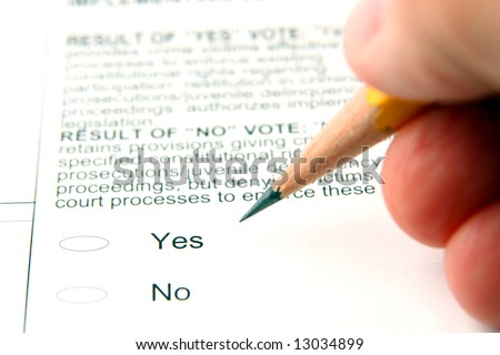 Person filling out ballot, shallow depth of field - stock photo