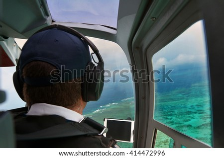Person fly in helicopter above the Great Barrier Reef Queensland Australia. - stock photo