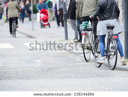 Person getting on bike - stock photo