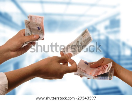 person handing money to another person detail - stock photo