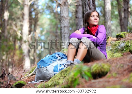Person hiking - woman hiker sitting in forest resting during hike in beautiful forest. Orotava vally, Aguamansa, Tenerife, Canary Islands. - stock photo