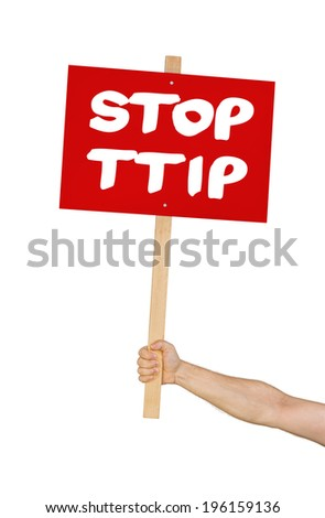 Person holding a sign saying Stop TTIP - stock photo