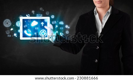 Person holding a white tablet with blue technology icons and symbols