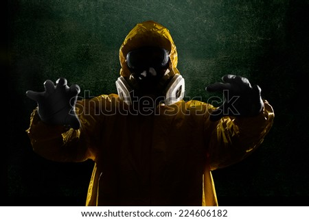 Person in Biohazard Suit coming for you - stock photo