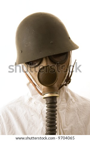 Person in gas mask and helmet on white background - stock photo