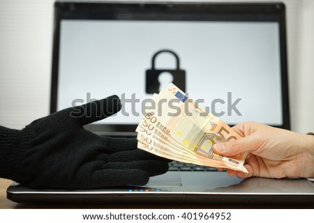 person is giving money to computer hacker to decrypt files, computer ransomware concept - stock photo