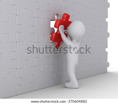 Person is putting the last piece of the wall puzzle - stock photo