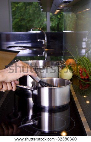 Person is stirring in a casserole