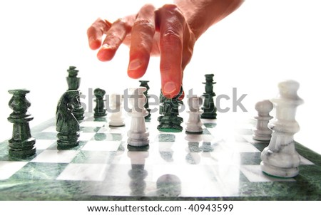 person moving a chess piece on the board, over white - stock photo
