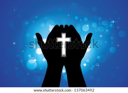 Person praying or worshiping with holy cross in hand - concept graphic illustration of a devout faithful christian worshiping Jesus Christ with blue background of stars and circles - stock photo