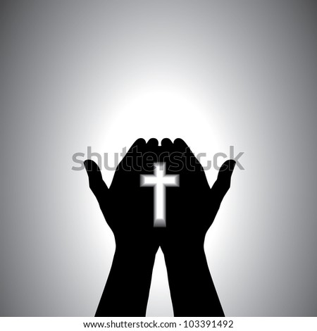 Person praying with cross in hand - concept of a devout christian worshipping christ - stock photo